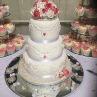 Wedding Cake 3 tier wedding cake, bottom fruitcake,middle almond cherry and top vanilla sponge. 100 vanilla cupcakes with Swiss butter cream. Cake and...