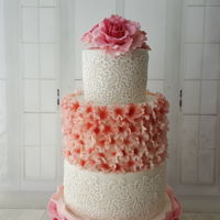 Wedding Cake Blossoms. Wedding cake with sugar peony's, blossoms , ruffles and edible lace.