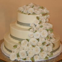 Wedding Cake Of Roses This was a 4 tier wedding cake (the Anniversary cake on a separate pedestal) done in buttercream icing, and covered by a cascade of white...