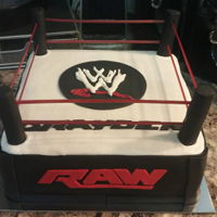 Wwe Cake The cake is covered with buttercream with fondant decor. I painted noodles with red food coloring/alcohol combination to go around the ring...