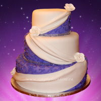 3 Tier Purple Fondant Wedding Cake 3 Tier Purple Fondant Wedding Cake with Scrolling, White Fondant Swags, Gumpaste Roses and trimmed with Bling.