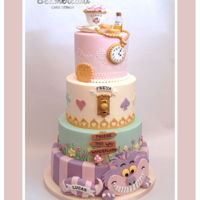 Alice In Wonderland Cake A 4 tiered Alice cake I made for a Christening for 4 children