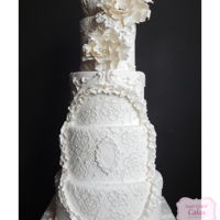 Baroque Inspired Pearly white wedding cake inspired by Baroque architecture and antique bridal gown fabric.