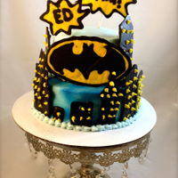 Batman   This is a yellow cake with butter cream icing. The buildings and batman symbol are out of melting chocolate.