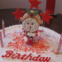 Birthday   A January 1st birthday. Buttercream covered white cake with gumpaste clock and stars.
