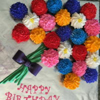 Birthday Cupcake Flower Bouquet   a buttercream flower cupcake bouquet tied with a fondant bow