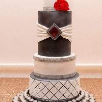 Black And White Wedding This cake was done for a fundraiser. Each layer was a different cake and filling combination covered with chocolate ganache and Satin Ice...