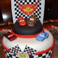 Cars Birthday Cake   Cars Theme fondant cake. Cars used were toys.