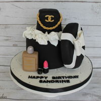 Chanel Gift Box Birthday Cake   Cake shaped in a Chanel Box. Purse, perfume and top of the gift box was made out of Rice Krispies.