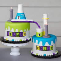 Chemistry Cake   science themed birthday cakes for twins. labware was made with rice krispy treats and MMF