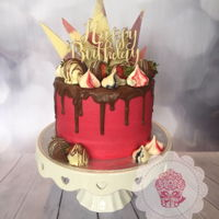 Chocolate Drip Cake With Chocolate Shards And Chocolate Strawberries Chocolate drip cake with multi colour chocolate shards, chocolate dipped and covered strawberries and merangue