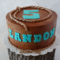 Cowboy Cake   Eight inch round in buttercream with Fondant decorations.