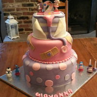 Doc Mcstuffin's Cake   Three tiered Doc McStuffins themed cake for little girl's birthday.