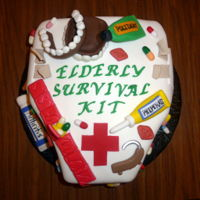 Elderly Survival Kit Cake This is a Humorous Birthday depend diaper cake with necessities for a 60 year old