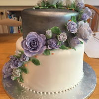 First Try At A Wedding Cake Lavender, silver and green color theme. I went with ombre lavender gumpaste roses, two fondant covered tiers with the top one painted in...