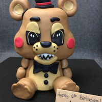 Freddy Fazbear Of Five Night's At Freddy's Vanilla cake with chocolate ganache filling. Here's the mini tutorial that I made ---> https://www.facebook.com/...