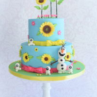 Frozen Fever Themed Birthday Cake Frozen Fever cake decorated with lots of sugar sunflowers and edible Olaf and snowgies.
