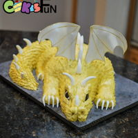 Gold Dragon Birthday Cake The dragons body, neck and tail are cake. The head and feet are RKT. Scales were individually cut for fondant (ouch!). Wings were cut from...