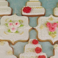 Gold & Pink Wedding Cake Cookies sugar cookies with corn syrup glaze & royal icing piped roses.
