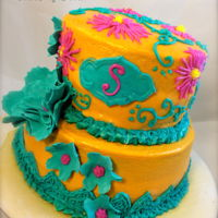Gold, Rose, And Turquoise  This is a chocolate and salted caramel cake. It is frosted with butter cream. The flowers are piped and made from sugar paste. Thanks for...