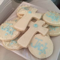 Jack's Christening Cross shaped sugar cookies w/royal icing and small rose.Vanilla cake w/vanilla frosting with blue and white roses