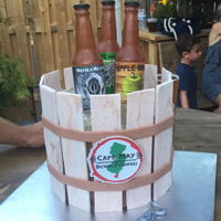 Jason's 30Th Birthday Cake  Edible beer bottles, ice and bucket (bottle opener too)! Cake is chocolate with peanut butter filling and buttercream icing. Beer bottles...