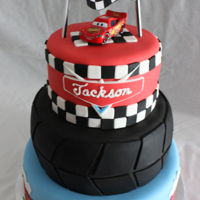 Lightning Mcqueen-Cars Cake Lightning McQueen and Radiator Springs theme cake for a little Cars fan birthday party. A client asked if I would replicate in fondant a...