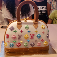 Louis Vuitton Purse Cake I made this Louis Vuitton bag-cake for Nikolina's 18th birthday.I combined the Hungarian chocolate cake and Japanese cotton sponge...