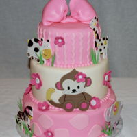 Pink Jungle Animals Baby Shower Cake White cake and cannoli filling is inside this fondant decorated cake. A client saw a similar cake on line. I needed to create my own...