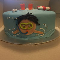 Pool Party Cake One tier fondant covered. Fondant boy, life preserver, and flippers