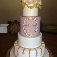 Purple And Gold Wedding Cake Gum paste roses,the bottom is dummy, other tiers are cakes, hope you like it