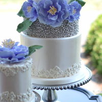 Purple Peony Wedding Cake   Purple peonies and ivory luster and drags on this wedding cake.