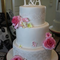 Romantic Weddingcake With Roses   A three tier weddingcake with handmade roses