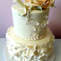 Rose And Ruffles   Two tiered wedding cake with a gum paste rose.