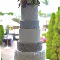Silver Beaded Cake   Tall cake with beads and ruffles.