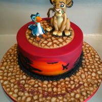Simba And Zazu This cake was created for a friend's daughter to celebrate her 16th birthday. Featuring hand modelled Simba and Zazu toppers using...