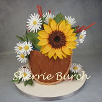 Sunflower & Daisies In Bucket Cake Mbalaska 7/31/2016 sugar flowers & leaves, fondant wood grain bucket, white cake with Swiss meringue buttercream icing.