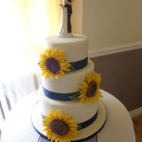 Sunflower Wedding Cake.  My friend asked me to make her brothers wedding cake This is what we came up with. Gumpaste sunflowers, which were the flowers in her...