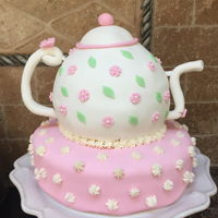 Teapot Birthday Cake Vanilla cake filled with vanilla buttercream covered in pink and white fondant