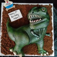 Trex Cake Hand carved T Rex with lots of layers of air brushing!