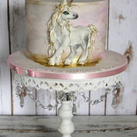 Unicorn Hand painted on icing unicorn on watercolour cake.