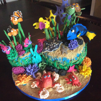 Vivi's Finding Nemo/dory Cake. She's 3!! I am a non professional baker and made this for my granddaughter. It is Sponge cake with lemon curd, stabilized whipped cream and Lemon...