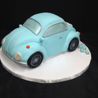Volkswagen Wedding Cake This red velvet Volkswagen Bug was the cutting cake for the couples cupcake display. I had sooo much fun making this :)