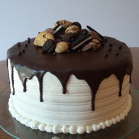 "3 Layers ""slutty Brownie Cake"" The 3 layers are chocolate chip cookie, cookie and cream and chocolate brownie cake. It is covered in vanilla smbc and poured ganache.(..."