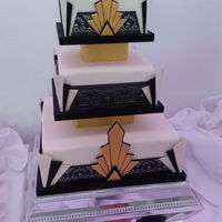 Art Deco Wedding Cake  Everything (except the polystyrene separators) is edible. Pastillage corners and decoration, black cake lace, white fondant. Vanilla...