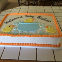 Baby Shower Cake Buttercream with fondant accents.