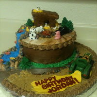 Barnyard Birthday! Chocolate cake with chocolate creme puff filling with RCT figurines and fondant. This was really fun because the sky was the limit on...
