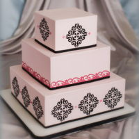 Classic Wedding Cake This is a classic. 3 tier square cake with cut out designs on the side. Thanks for looking!