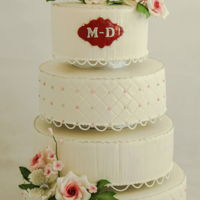 Classic White Wedding Cake Here his a classis wedding cake with gumpaste flowers. Really proud of this one