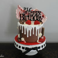 Drip Cake   Drip cake loaded with chocolate, strawberries and a big chunk of white and red chocolate bark.